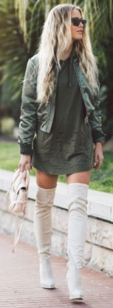Green bomber jacket, khaki mini dress, off-white suede over the knee boots and nude leather satchel bag. Street style | casual outfits | trending jackets | outfit ideas