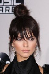 Kendall Jenner top knot with choppy fringe ~ celebrity hairstyles ~ hair , beauty & make up