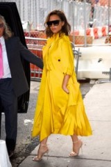 Victoria Beckham style. Chic celebrity outfits | yellow statement coat
