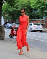 Victoria Beckham stunning in coral statement outfit. Celebrity outfits | street style chic