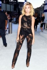 Hailey Baldwin in a sheer black jumpsuit by Georges Chakra at the MTV VMAs 2016