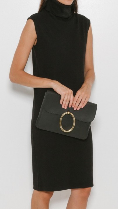 A Detacher ~ Lou black leather clutch bag with brass oval embellishment – large envelope bags – smart luxe handbags