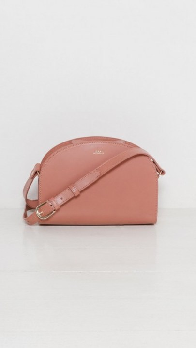 A.P.C. Sac Demi Lune warm blush. Luxe crossbody bags | pink leather handbags | designer accessories - flipped