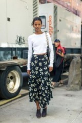 Liya Kebede looking lovely & a bit more casual in a close fitted round neck white t-shirt, a dark floral print long layered skirt, with asymmetric hem, & a pair of navy high heeled clogg mules at NYFW Spring/Summer 2017 ~ New York Fashion Week S/S 17 street style ~ outfits ~ women with style