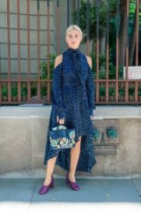 Women with style at NYFW S/S 2017 ~ stylish outfits ~ New York street style ~ navy with white spots Magda Butrym cold shoulder dress with neck tie and asymmetric hemline ~ chic feminine dresses
