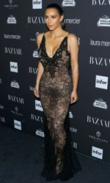 "Kim Kardashian wearing a black lace Givenchy gown at Carine Roitfeld's ""Harper's Bazaar"" Icons party during NYFW, September 2016. Celebrity glamour 