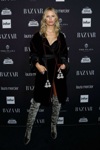 "Model Karolina Kurkova in a deep purple velvet robe and grey over the knee boots at the Carine Roitfeld's ""Harper's Bazaar"" Icons party in NYC, September 2016. Celebrity fashion 