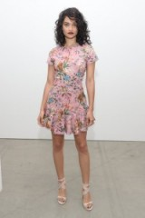 Shanina Shaik in a pretty pink bird and floral print mini dress and nude leather ankle wrap sandals at Zimmermann – front row celebrities at New York Fashion Week Spring 2017. Celebrity fashion | star style outfits