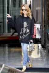 Singer Celine Dion street style, August 2016…leaving her hotel in Paris wearing a Vetements Titanic print oversized hoodie, jeans and a pair of GUCCI metallic gold sandals, available from gucci.com. Casual celebrity fashion | star style outfits | designer high heels | ankle strap shoes