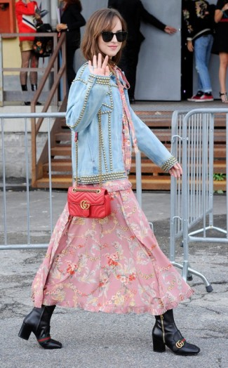 260dad43742 Dakota Johnson dressed in a perfect mix of Gucci pink and blue at Milan  Fashion Week