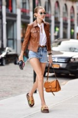 Gigi Hadid models casual style…tan & brown leather with blue washed denim shorts – models style – celebrity outfits
