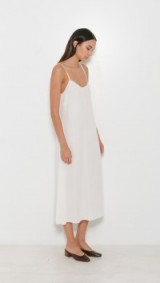 Jesse Kamm The Slip Dress in cream. Designer cami dresses | strappy fashion | minimal style | on trend | clothing trending now | spaghetti straps | thin strap