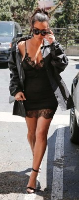 Kim Kardashian black mini slip dress with lace trim. Celebrity cami dresses | Kardashian's fashion | star style outfits
