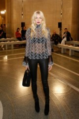 Jessica Hart in a sheer high neck blouse with bell cuffs and black leather skinny pants at the Christopher Kane S/S 2017 show during LFW. Celebrity outfits | star style fashion | front row celebrities