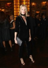 Caroline Winberg attends the 4th Annual Business of Fashion 500 Gala wearing a black velvet trouser suit and barely there heels. Celebrity fashion | models at events | star style trouser suits