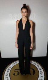 Model Taylor Hill looks chic in a simple plunge front, halterneck jumpsuit at the Business of Fashion 500 Gala held in London, September 2016. Celebrity jumpsuits | star style event fashion | models at events