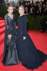 Mary-Kate and Ashley Olsen attend the Met Gala in 2014. Celebrity sisters   stylish twins   star style gowns   red carpet fashion   style icons