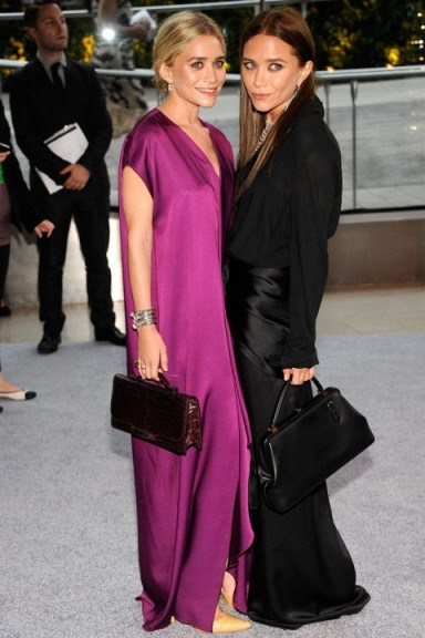 Mary-Kate and Ashley Olsen both look effortlessly stylish at the 2012 CFDA Fashion Awards. Stylish sisters | celebrity twins | style icons | black and purple | chic evening outfits | event fashion - flipped
