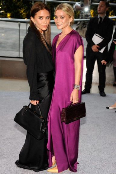 Mary-Kate and Ashley Olsen both look effortlessly stylish at the 2012 CFDA Fashion Awards. Stylish sisters | celebrity twins | style icons | black and purple | chic evening outfits | event fashion