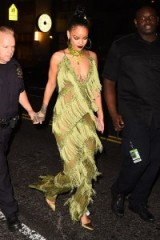 Rihanna looked stunning dressed for the 2016 VMAs after party, wearing in a chartreuse fringed jumpsuit which was custom made by L'Impasse Boutique in NYC. Celebrity fashion | star style outfits | green jumpsuits | glamorous celebrities
