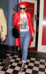Rita Ora rocking a red leather trench, graphic tee, boyfriend jeans, metallic star print boots and red beret – celebrity style fashion – casual outfits – star coats