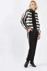 Topshop Stripe Sequin Bomber Jacket as worn by Olivia Palermo at London Fashion Week, September 2016. Casual jackets | sequined outerwear | black and white stripes | on trend fashion