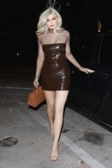 Kylie Jenner evening glamour…strapless brown latex bodycon dress worn over a sheer top, strappy sandals and a tan handbag. Celebrity outfits | star style dresses