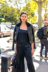 Model Georgia Fowler's street style during Paris fashion week SS17…black leather biker jacket with shearling collar and loose fit jumpsuit with large front pockets