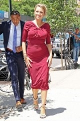 Blake Lively pregnancy style in a fitted red ruched dress
