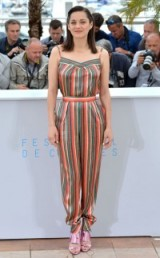 Marion Cotillard at the 2015 Cannes Film Festival wearing an Ulyana Sergeenko green and orange stripe jumpsuit with pink metallic sandals – French style – celebrity fashion