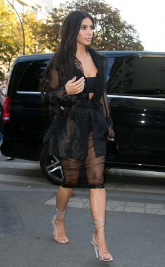 kim kardashian style�sheer black outfit and silver strappy