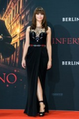 Felicity Jones looking gorgeous wearing a black Alexander McQueen sleeveless gown, designed with a wrap style skirt and a sheer jewel embellished bodice, at the German premiere of Inferno, Oct 2016 ~ Women with style ~ celebrity gowns ~ glamorous looks
