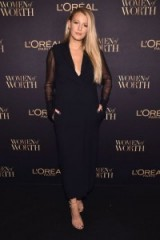 Blake Lively attends the L'Oréal Paris's Women of Worth celebration in New York City, dressed in a long black Lanvin dress with sheer sleeves and nude barely there sandals