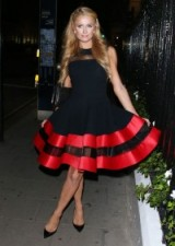 Paris Hilton style…black and red sleeveless fit and flare dress with black accessories