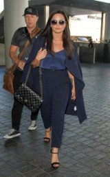 Demi Lovato travel style in a chic navy blue outfit carrying a Chanel flap bag at LAX, November 2016. Celebrity outfits | star style fashion | celebrities at airports