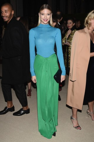 Model Martha Hunt wears a blue ribbed turtleneck sweater and long green front tie skirt to the 13th Annual CFDA/Vogue Fashion Fund Awards, held at Spring Studios in NYC, 7 November 2016. Models style | celebrity outfits | celebrities at events