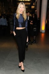 Model Martha Hunt looks chic in a blue cropped blouse, black pants and pointy pumps attending the WSJ Magazine 2016 Innovator Awards at Museum of Modern Art in NYC, 2 November 2016. Models style | celebrity outfits