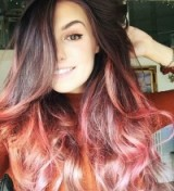 Marzia Bisognin's dark brown long hair with pink ombre ends. Celebrity hairstyles | make up and beauty