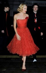 Sienna Miller wearing a red strapless vintage cocktail dress to Mario Testino's 60th Birthday Party in 2014