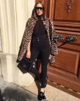 Olivia Culpo looks so glamorous wearing these high waist trousers, high neck blouse and a faux fur leopard print coat. Celebrity street style | chic outfits | animal print coats