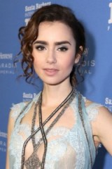 Lily Collins messy updo with front ringlets. Celebrity hair | star hairstyles | updos | beauty and make up
