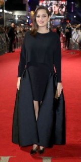 Marion Cotillard's red carpet pregnancy style dressed in custom Stella McCartney and statement Chopard diamond drop earrings. French chic style | celebrity gowns | star style dresses