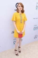 Emma Stone in a little yellow shift dress attending The Hollywood Reporter's Annual Women in Entertainment breakfast. Celebrity fashion | star style dresses