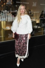 Kate Foley wears a fitted white blouse with balloon sleeves and a sequined maxi skirt with side slit to the opening of Monica Vinader's US flagship boutique. Style icons | celebrity fashion | chic outfits