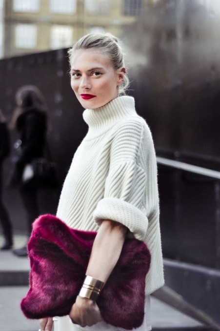 Chunky ivory ribbed sweater with large purple fluffy clutch | street style chic - flipped