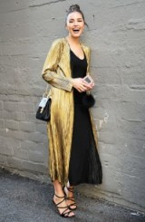 Olivia Culpo's long gold coat