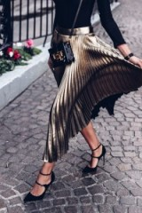 Add a touch of glamour with a pleated metallic midi skirt