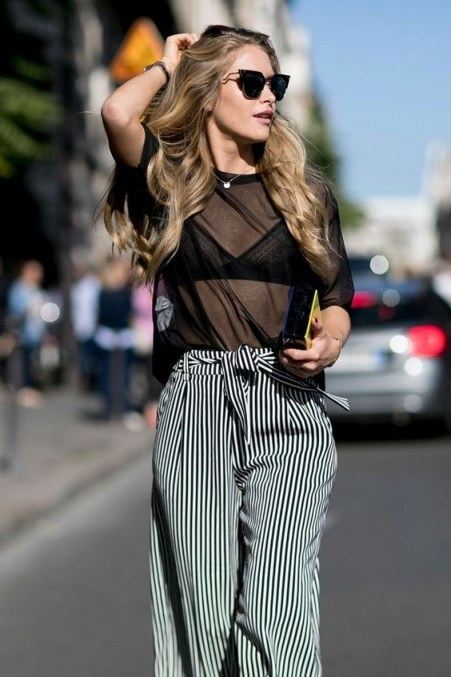 Street style chic…sheer black top and stripe wide leg trousers with waist tie. Outfits for warmer weather | stylish sprint outfit | fashion inspiration - flipped
