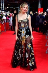Sienna Miller on the red carpet at the Berlin Film Festival, dressed in a sheer floral Dior gown, attending the premiere of The Lost City Of Z