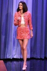 Model Kendall Jenner in a pink Chanel suit, white crop top and nude courts, appears on The Tonight Show Starring Jimmy Fallon, Feb 2017
